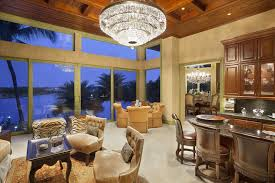 luxury craftsman living room with view of c and large crystal chandelier