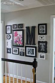 Little Bits of Home: Hallway Gallery Wall / I like this arrangement,  perhaps upstairs hall? Love how the light switches and thermostat are  incorporated into ...