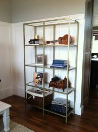Nice Chrome Iron Shelving Unit Ideas With 4 Tier Glass Top Shelf For Crafts  Collection Storage In Simplistic Interior Decors