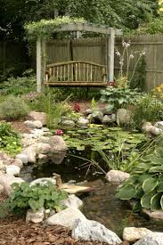 Interesting BDA/naa Pond built swing hung gazebo built just working on  making a English garden. Rustic swing by a backyard pond and stream.