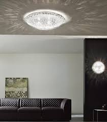 modern flush ceiling light collection featuring an unusual patterned glass shade and chrome metal frame available in four sizes with matching suspension
