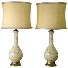 pair of mid century lamps in glass hollywood regency for