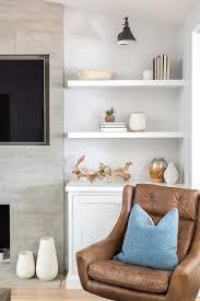 floating fireplace shelves over cabinet