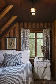 small cabin furniture. now used as a guest room one of the cabinu0027s small bedrooms features gorgeous vertically stacked roundlog walls exposed log rafters and an angled cabin furniture o
