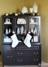 Christmas china cabinet decor - part of the holiday home tour at  madiganmade.com