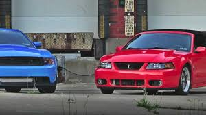 2004 SVT Cobra vs Supercharged 2012 Mustang GT - YouTube