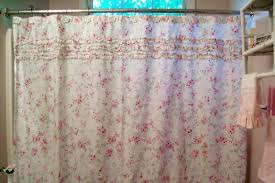 white fabric shower curtain flower detail
