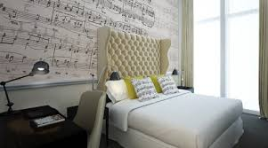 Very stylish orchestral inspired bedroom. Especially like the sheet music  on the wall.