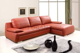 comfortable leather sectional couch with adjustable armrests and loose back pillows