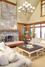 furnitures traditional living room with white sofa and upholsteded coffee table and stone fireplace traditional