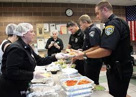 sandra anderson left of elyria olive garden serves lunch to police officers from