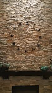 hang on a stone wall without drilling