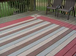 faux rug painted on deck i would use diffe colors but looks easy enough