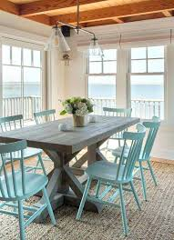 dining room table rug a weathered dining table and light blue chairs reflect the views that stretch out beyond this dining room a natural woven area rug