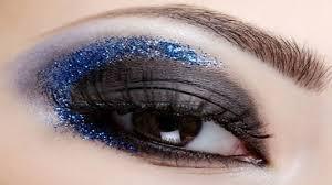 bright eye makeup of blue glitter look free