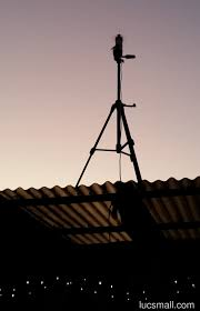 a 16 radial spider antenna for adsb mounted on a tripod at sunset