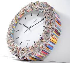 Small Picture Magazine Wall Clock Designers turn old magazines into a trendy