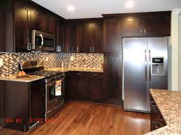 kitchens with dark brown cabinets. White Wooden Kitchen Island Dark Cabinets With Light Countertops Gloss Black Glass Top Stainless Steel Cabinet Microwave Kitchens Brown