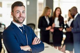 Businessman Leader In Modern Office With Businesspeople