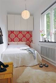 Collect this idea photo of small bedroom design and decorating idea - pink  and white