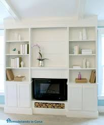 bookcase built ins with fireplace insert featuring remodelando la casa