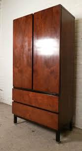 sleek mid century modern armoire style dresser by martinsville at