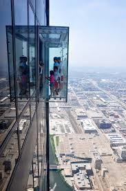 skydeck visitors can walk onto the ledge enclosed glass balconies protruding 4 3 feet from the