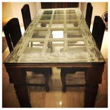 dining table made of an old door so cool