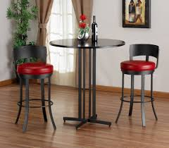 contemporary bar table sets with rounded tall table made of black metal combined with low back stools