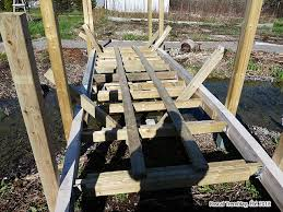 build small arched wooden bridge over pond