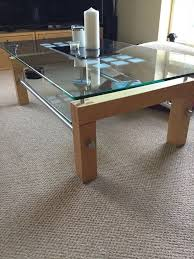 coffee table in natural light oak rectangle with heavy glass top and lower shelf