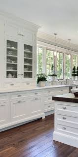 White kitchen design ideas. Love the cabinet for dishes, and that the  cabinetry is