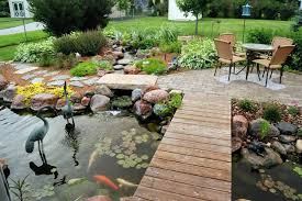 here s a cool backyard pond with a wooden walkway