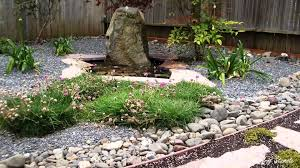 Dashing Pond Near Beautiful Flowers And Gravel For Japanese Garden Design