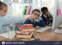 Kids As Business Executives Discussing Over Desktop Pc In