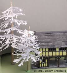 Make Simple Winter Trees From Cut Paper SnowflakesSnowflakes For Christmas Tree
