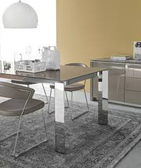 gate modern extending dining table with a glass top and brushed metal or chrome legs by