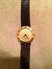 gucci 8000m. gucci 3000i 18k gold-plated roman numeral bezel face 26mm watch brown leather gucci 8000m o