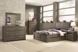 Ashley Juararo Panel Bedroom Set with Under Bed Storage in Dark Brown