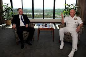 u s department of defense photo essay deputy defense secretary william j lynn iii talks u s navy adm robert f