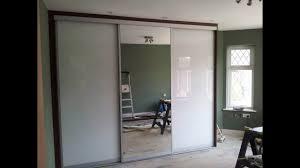 top photo of custom made sliding door wardrobe white glass mirror you sliding