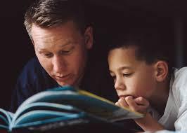 Teens reading aloud to