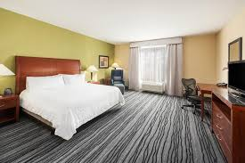 a bed or beds in a room at hilton garden inn st louis shiloh