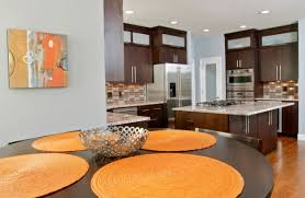 View in gallery Simple additions like wall art and dining table mats can  bring in orange accents