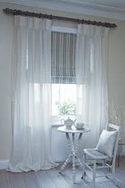 Sheer curtains with roman shade.