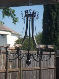 tinkering around chandelier turned bird feeder for chandelier bird feeder
