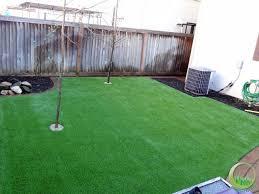 backyard with a concrete patio in fairfield california synthetic artificial grass in bay area california