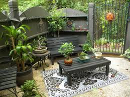 Black wooden patio chairs and black wooden patio table with rectangular shape patio furniture for small spaces