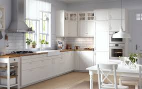 White wood kitchen Rustic Traditional Kitchen With White Cabinets Wood Worktops Glass Doors And Integrated Appliances Houselogic Kitchens Browse Our Range Ideas At Ikea Ireland