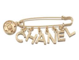 chanel pin. chanel costume jewelry safety pin brooch with \ i